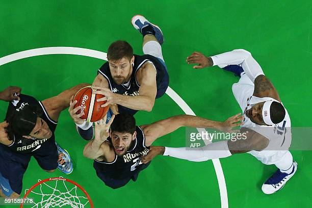 An overview shows Argentina's shooting guard Patricio Garino and Argentina's small forward Andres Nocioni jumping for the ball during a Men's...