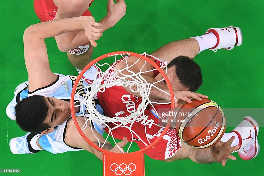 TOPSHOT An overview shows Argentina's small forward Gabriel Deck and Croatia's centre Darko Planinic go for a rebound during a Men's round Group B...