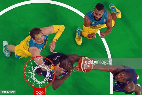 An overview shows Australia's centre David Andersen USA's forward Draymond Green Australia's guard Patty Mills and USA's guard Kevin Durant go for a...