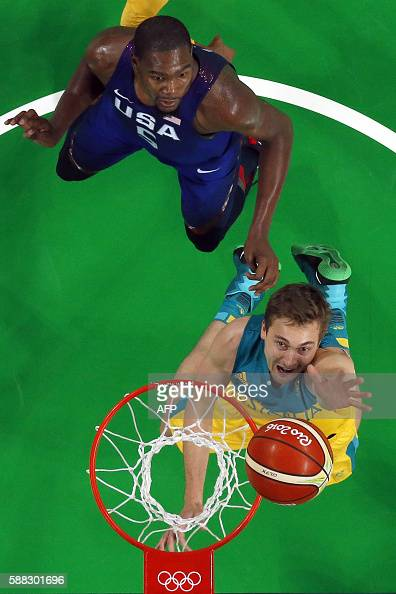 An overview shows Australia's forward Ryan Broekhoff and USA's guard Kevin Durant go for a rebound during a Men's round Group A basketball match...