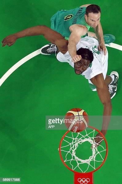An overview shows Brazil's point guard Marcelinho Huertas and Nigeria's power forward Ike Diogu eye a rebound during a Men's round Group B basketball...