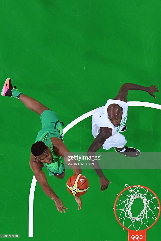 An overview shows Brazil's shooting guard Leandro Barbosa and Nigeria's small forward AlFarouq Aminu go for a rebound during a Men's round Group B...