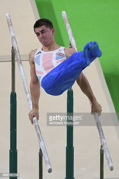 An overview shows Britain's Max Whitlock competing in the parallel bars event of the men's individual allaround final of the Artistic Gymnastics at...