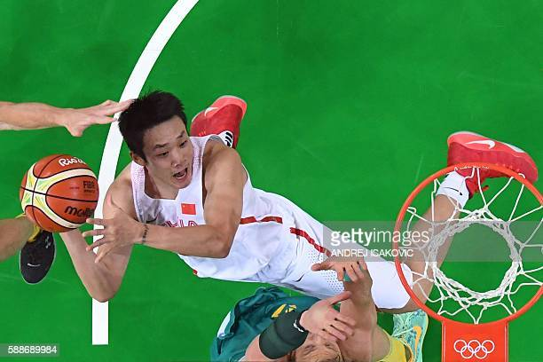 An overview shows China's small forward Ding Yanyuhang take a shot during a Men's round Group A basketball match between China and Australia at the...