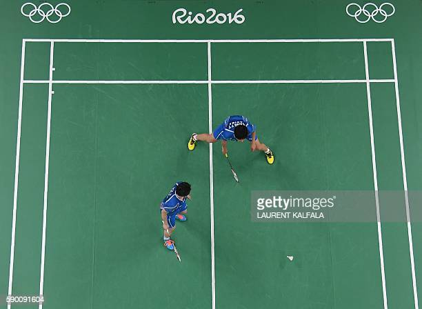 An overview shows China's Tang Yuanting and China's Yu Yang look at the shuttlecock as they both fail to return against Denmark's Christinna Pedersen...
