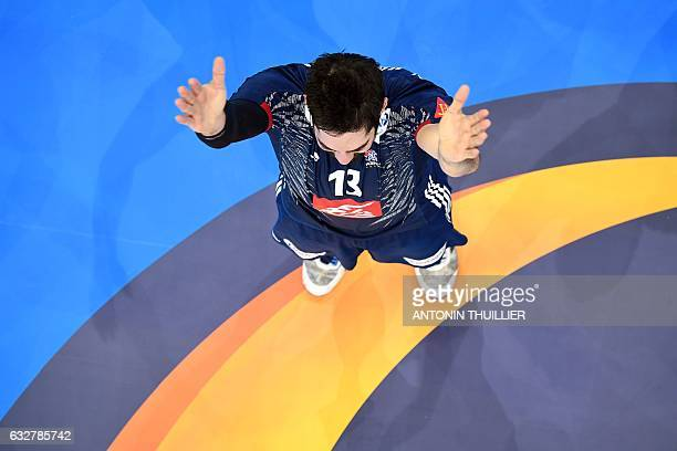 TOPSHOT An overview shows France's centre back Nikola Karabatic react after France won the 25th IHF Men's World Championship 2017 semifinal handball...