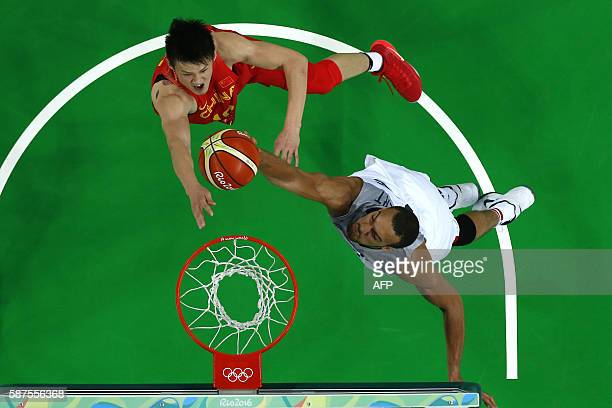 An overview shows France's centre Rudy Gobert blocking a shot by China's forward Zhou Peng during a Men's round Group A basketball match between...
