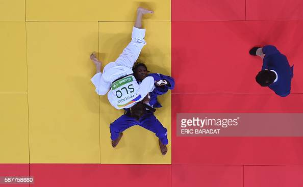 TOPSHOT An overview shows France's Clarisse Agbegnenou competing with Slovenia's Tina Trstenjak during their women's 63kg judo contest gold medal...