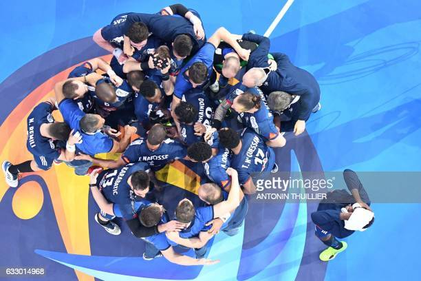 TOPSHOT An overview shows France's players and staff gathering on the court after winning the 25th IHF Men's World Championship 2017 final handball...