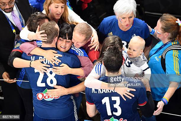 TOPSHOT An overview shows France's right back Valentin Porte and France's centre back Nikola Karabatic celebrate with relatives after France won the...