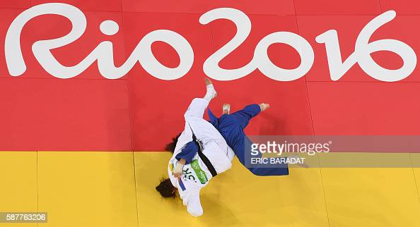 TOPSHOT An overview shows Israel's Yarden Gerbi competing with Japan's Miku Tashiro during their women's 63kg judo contest bronze medal A match of...