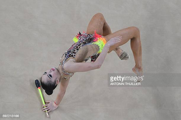 An overview shows Japan's Kaho Minagawa competing in the individual allaround qualifying event of the Rhythmic Gymnastics at the Olympic Arena during...