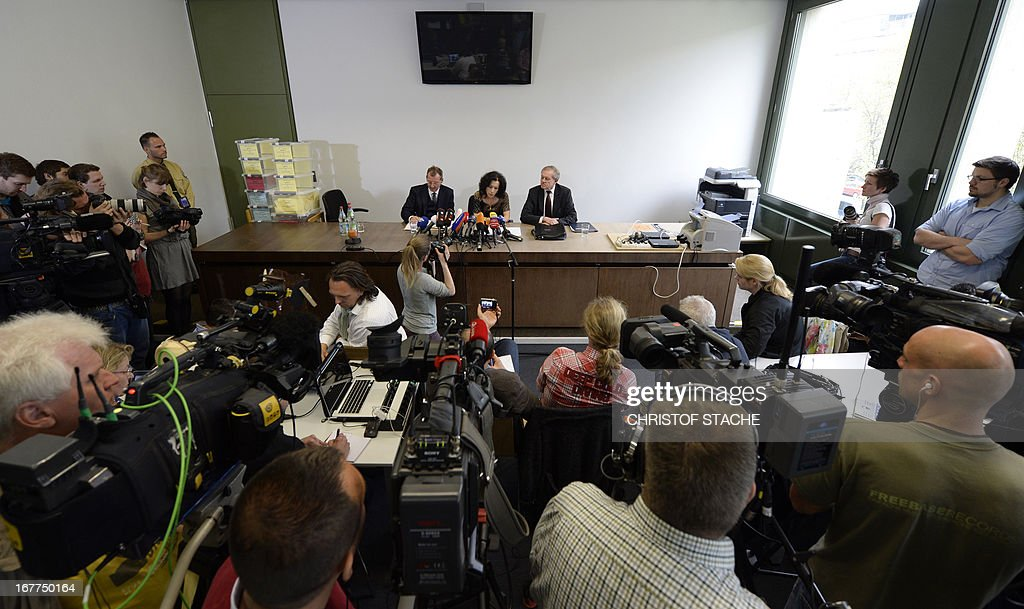 An overview shows journalists, camera teams as well as German notary Dieter Mayer (backL) and Karl Huber (backR), President of the Higher Regional Court Munich (Oberlandesgerichtes Muenchen), attend a press conference on April 29, 2013 in Munich, southern Germany after the lottery of the reserved press seats for the trial against the sole survivor of the far-right militants NSU and four other alleged neo-Nazi accomplices, to take place on May 6, 2013.