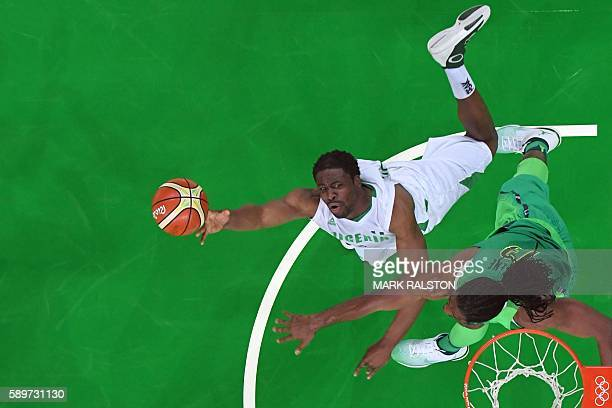 An overview shows Nigeria's power forward Ike Diogu and Brazil's centre Nene Hilario go for a rebound during a Men's round Group B basketball match...