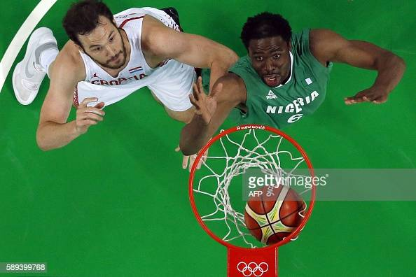 An overview shows Nigeria's power forward Ike Diogu and Croatia's centre Miro Bilan eye a rebound during a Men's round Group B basketball match...