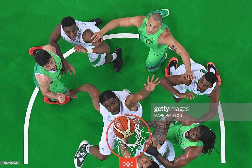 An overview shows Nigeria's power forward Ike Diogu Brazil's power forward Guilherme Giovannoni Brazil's small forward Alex Garcia and Brazil's...