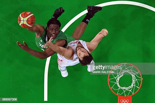 An overview shows Nigeria's power forward Ike Diogu go to the basket against Croatia's centre Miro Bilan during a Men's round Group B basketball...