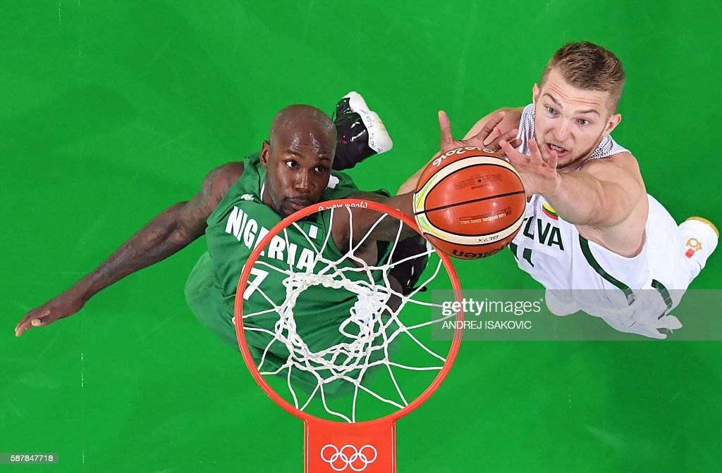 An overview shows Nigeria's small forward AlFarouq Aminu and Lithuania's power forward Domantas Sabonis go for a rebound during a Men's round Group B...