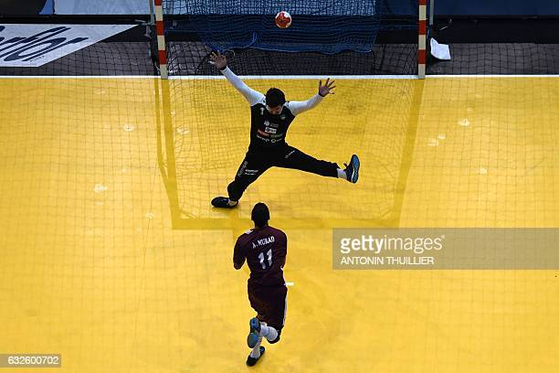 TOPSHOT An overview shows Qatar's left wing Murad Abdulrazzaq scoring a goal past Slovenia's goalkeeper Matevz Skok during the 25th IHF Men's World...