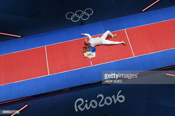 TOPSHOT An overview shows Russia's Timur Safin celebrating after winning the mens team foil gold medal bout between France and Russia as part of the...
