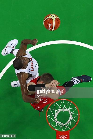 An overview shows Serbia's centre Vladimir Stimac and USA's guard Kevin Durant go for a rebound during a Men's round Group A basketball match between...