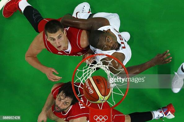 An overview shows Serbia's guard Milos Teodosic Serbia's power forward Nikola Jokic and USA's guard Kevin Durant eye a rebound during a Men's round...