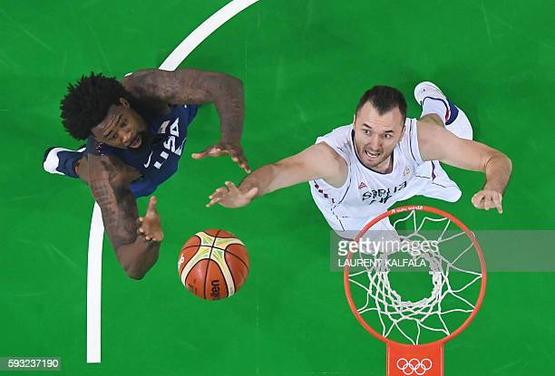 An overview shows Serbia's power forward Milan Macvan jumping for the ball with USA's centre DeAndre Jordan during a Men's Gold medal basketball...