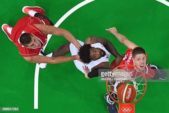 TOPSHOT An overview shows Serbia's power forward Nikola Jokic USA's centre DeAndre Jordan and Serbia's centre Vladimir Stimac eye a rebound during a...