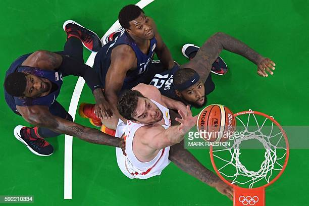 TOPSHOT An overview shows Spain's centre Pau Gasol go to the basket as USA's guard Kyrie Irving USA's guard Kyle Lowry and USA's centre DeMarcus...