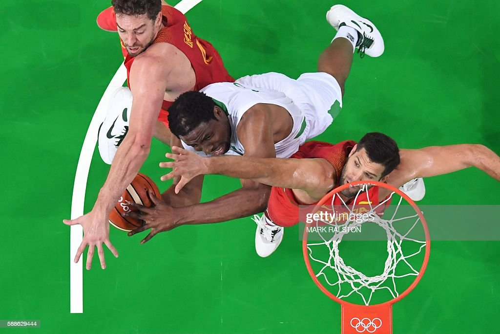 An overview shows Spain's centre Pau Gasol Nigeria's power forward Ike Diogu and Spain's power forward Felipe Reyes go for a rebound during a Men's...