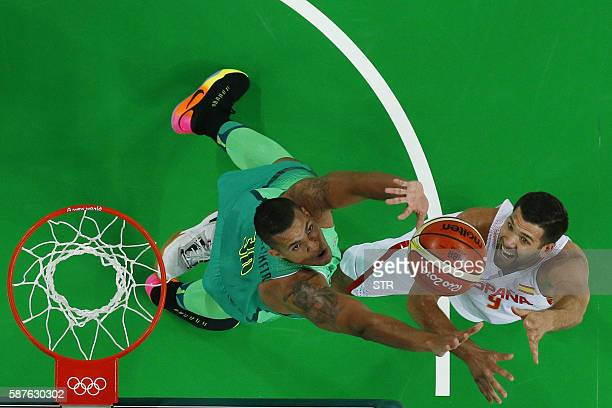 TOPSHOT An overview shows Spain's power forward Felipe Reyes jumping for the ball with Brazil's power forward Rafael Hettsheimeir during a Men's...