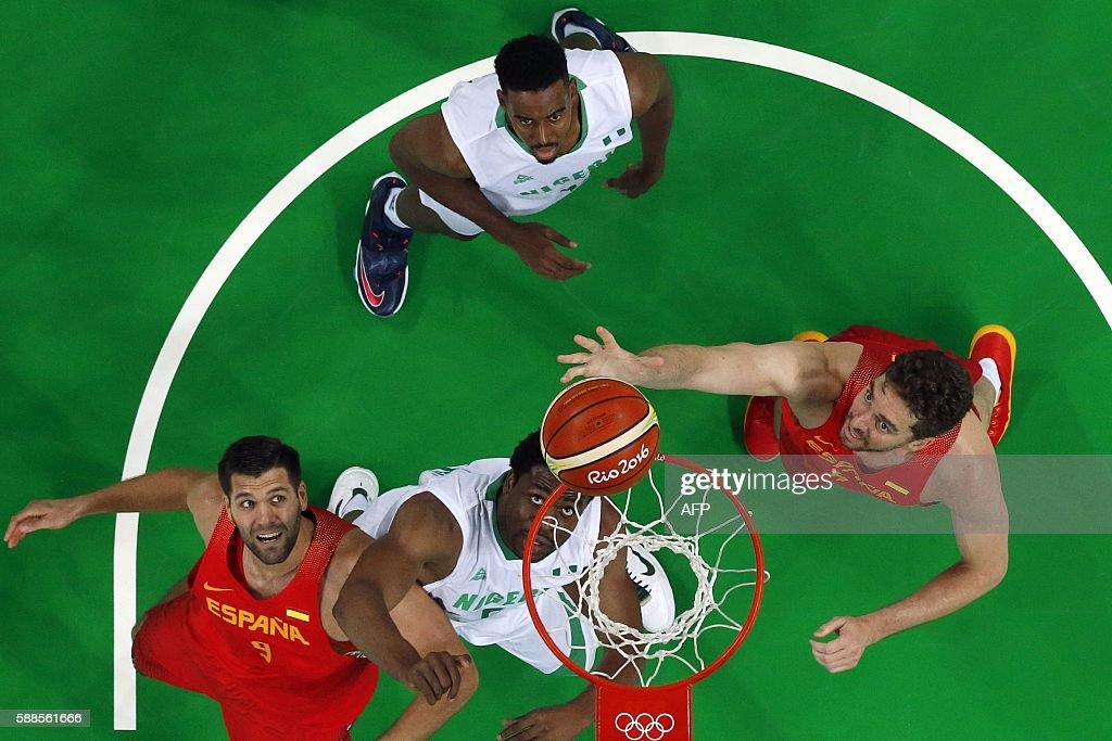 TOPSHOT An overview shows Spain's power forward Felipe Reyes Nigeria's power forward Ike Diogu 9C and Spain's centre Pau Gasol eye a rebound during a...