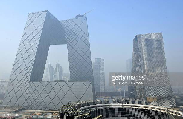An overview shows the yet infinished future headquarter towers for China Central Television on the left and the burnt remains of the also yet to open...