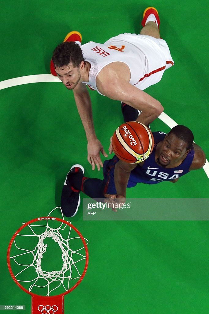 An overview shows USA's guard Kevin Durant and Spain's centre Pau Gasol eye a rebound during a Men's semifinal basketball match between Spain and USA...