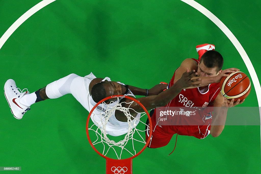 An overview shows USA's guard Kevin Durant defend against Serbia's power forward Nikola Jokic during a Men's round Group A basketball match between...