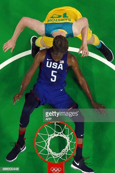 An overview shows USA's guard Kevin Durant fall next to Australia's forward Cameron Bairstow during a Men's round Group A basketball match between...