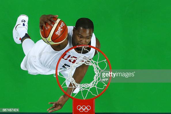 An overview shows USA's guard Kevin Durant scoring during a Men's round Group A basketball match between USA and Venezuela at the Carioca Arena 1 in...