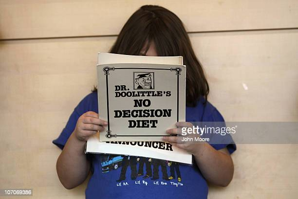 An overweight child reads her part in a humorous skit held during the Shapedown program for overweight adolescents and children on November 20 2010...