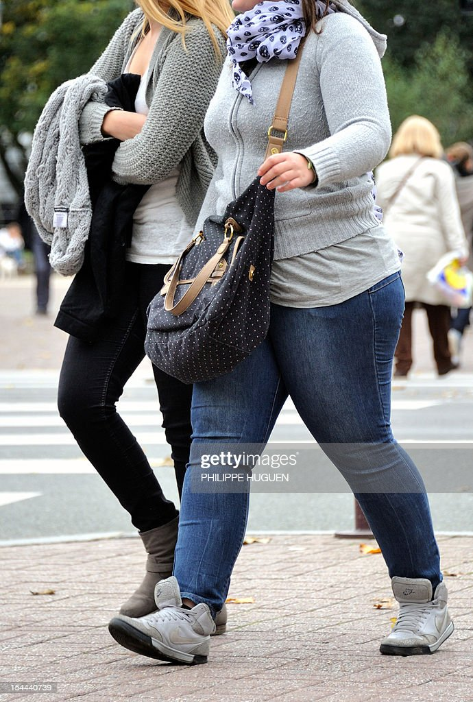 LAOUCHEZ - An overweight person walks in a street of the northern city of Lille on October 19, 2012.