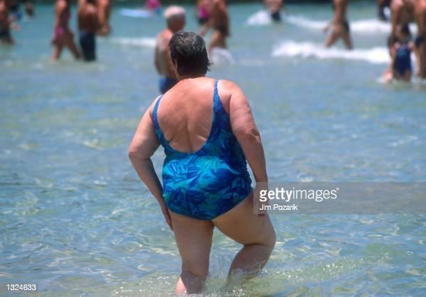 An overweight woman enjoys the surf January 2001 at Bondi Beach in Sydney Australia