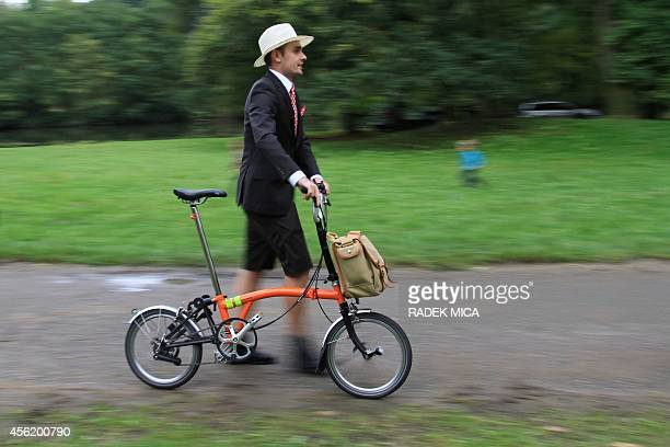 An owner of a traditional English Brompton folding bikes attends a Czech championship race on September 27 2014 in Lednice near John's castle South...