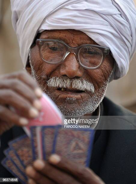 An Pakistani elderly man plays cards in a slum area of Islamabad on February 1 2010 Longer lifespans falling fertility rates and growing ranks of...