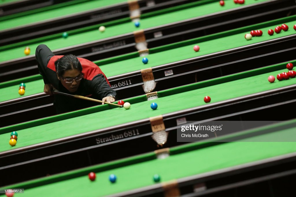 An player from the Malaysian team takes a shot during his Men's Snooker Team Round of 16 Match against Singapore at Songdo Convensia on day three of the 4th Asian Indoor & Martial Arts Games on July 1, 2013 in Incheon, South Korea.