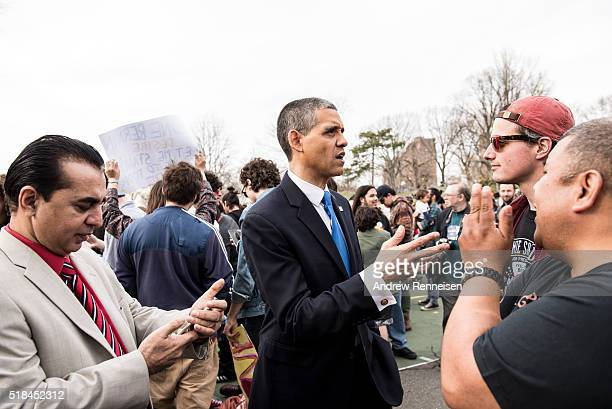 An President Obama impersonator talks to attendees at a rally for Democratic Presidential Candidate Senator Bernie Sanders at St Mary's Park in the...