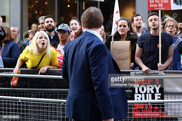 An protester confronts a delegate attending the first day of the Conservative Party Autumn Conference 2015 on October 4 2015 in Manchester England Up...