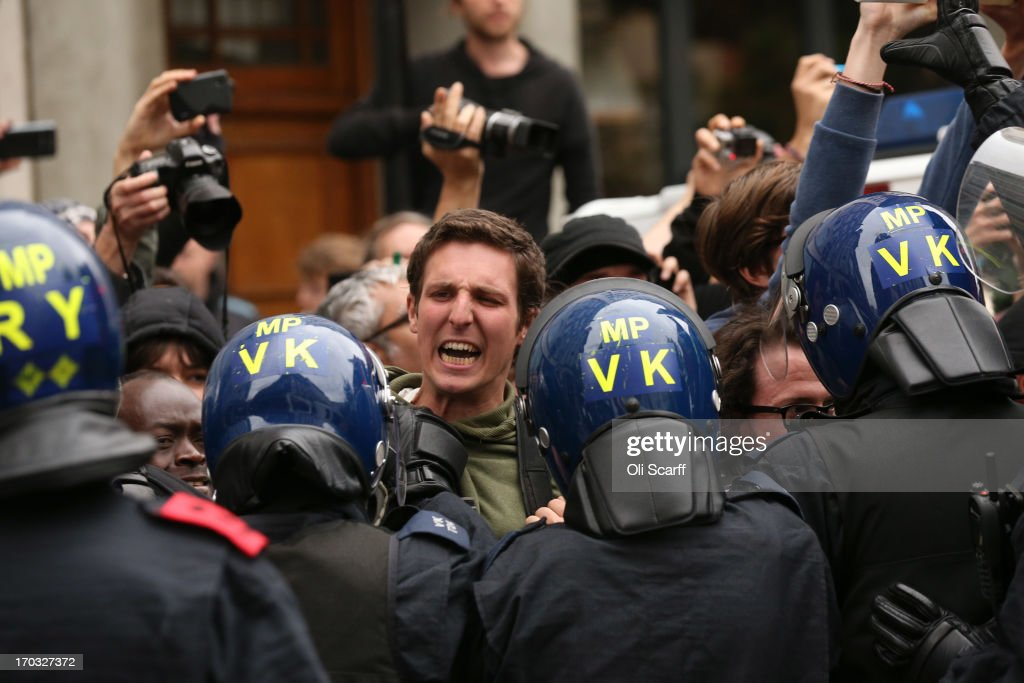 An protester shouts as police detain activists after they occupied a convergence centre of the Stop G8 protest group off Beak Street ahead of next week's G8 summit in Northern Ireland on June 11, 2013 in London, England. Next week will see Enniskillen in Northern Ireland host the two day G8 summit where international leaders including Britain's Prime Minister David Cameron and US President Barack Obama take part in the two day event. The chosen location is only 8 kilometers from the scene of one of Northern Ireland's worst killings back in 1987, however Cameron is confident that it's secluded location will deter any potential trouble.
