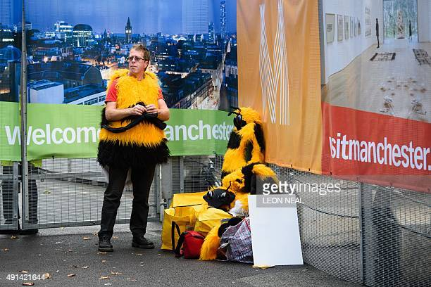 An protestor puts on a bee costume outside the secure cordon on the second day of the annual Conservative party conference in Manchester north west...