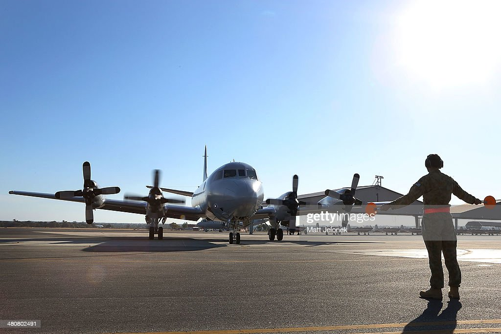 An RAAF P3 Orion returns from the first flight today Pearce Air Base on March 27 2014 in Perth Australia New images overnight have been released by a...