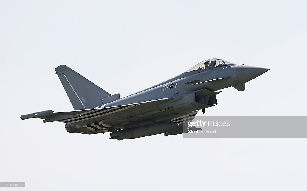 An RAF Eurofighter Typhoon piloted by Flight Lieutenant Noel Rees performs a flypast during the unveiling of the commemorative DDay Eurofighter...