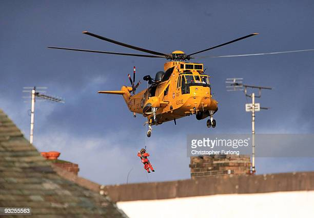 An RAF rescue helicopter rescues people from their homes in the centre of Cockermouth on November 20 2009 in Cockermouth United Kingdom A major...